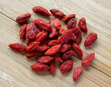 Heap of Dry Goji Berries on the Wooden Table