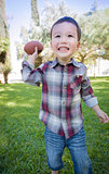 Cute Young Mixed Race Boy Playing Football Outside