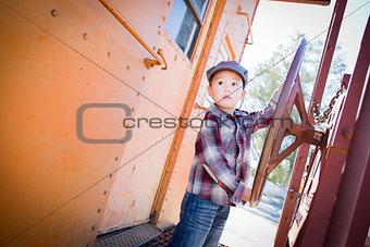 Cute Young Mixed Race Boy Having Fun on Railroad Car