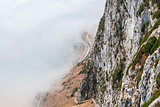 Gibraltar cliff face above fog