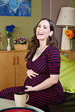 Sitting Pregnant Woman Laughing