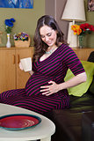 Pregnant Person Looking Down