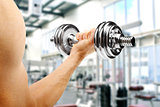 gym. man with dumbbell in the hand