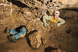 A young girl stuck in cave hole