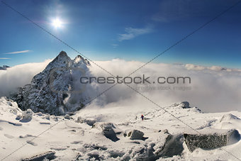 Alpinist climbing on Rysy mountain peak in High Tatras. Slovakia