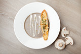 Vegetarian mushroom cream soup purée with baked bread cheese sl