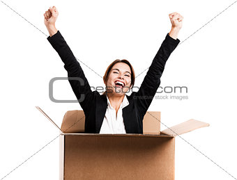 Business woman appear inside a big card box
