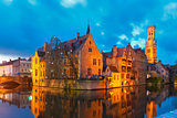 Cityscape with a tower Belfort from Rozenhoedkaai in Bruges at s