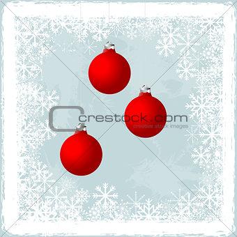 Christmas balls over a frozen window