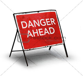 Grungy road sign danger ahead