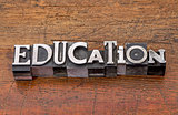 education word in metal type