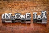 income tax in metal type