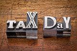 tax day in metal type