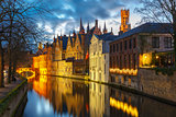 Cityscape with a tower Belfort and the Green canal in Bruges at