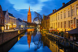 Cityscape with canal Dijver and a Church of Our Lady in Bruges