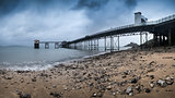 Pier landscape panorama on moody sky day