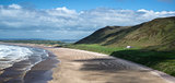 Panorama landscape Rhosilli Bay beach in Wales on Summer day