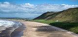Panorama landscape Rhosilli Bay beach in Wales on Summer day