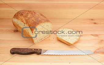 Bread knife with freshly sliced loaf of bread