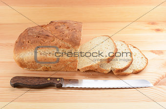 Three slices cut from a loaf of bread with a knife