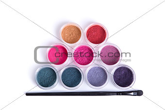 Top view of mineral eye shadows and brush