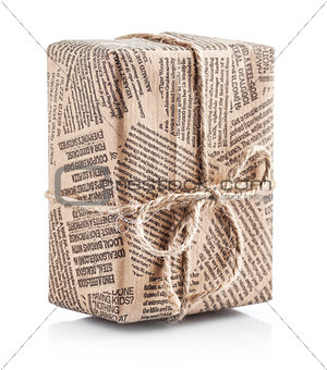 Box packaged newspaper with bow of rope