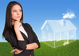 Businesswoman looking at imaginary house