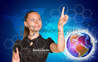 Beautiful woman in dress pointing on two blank icon cells, out of many