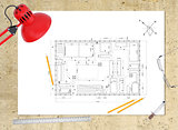 Technical plan of building on workplace. table-lamp, ruler, pencils compasses and eyeglasses around