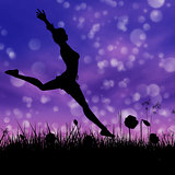 Silhouette of a girl jumping on the meadow