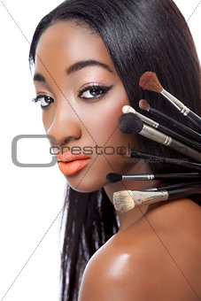 Black woman with straight hair and makeup brushes