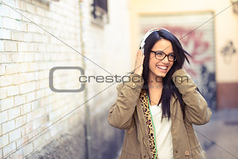 Young attractive girl in urban background