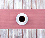 Coffee cup top view on wooden and tissue