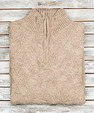 Sweater on wooden background