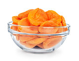 dried apricots in a glass bowl isolated on white background