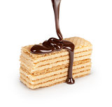 on vanilla wafer pouring chocolate on white background