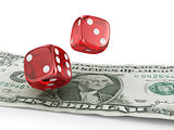 Pair of red dice on one dollar banknotes.