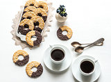 Chocolate cookies with two cups of coffee