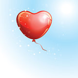 Heart shaped red balloon in the sky to the Valentines day.