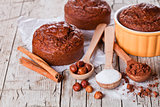 fresh baked browny cakes, sugar, hazelnuts and cocoa powder