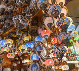 Ornate lamps hanging at a market