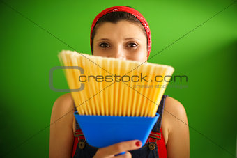 Portrait Of Happy Woman Doing Chores Holding Broom