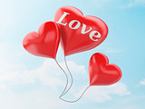 3d red heart balloons. valentine's day concept in the blue sky.