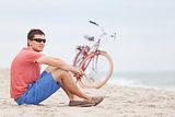 man biking at the beach