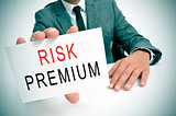 businessman with a signboard with the text risk premium
