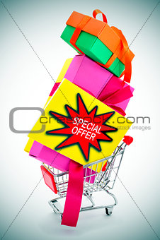 boxes and signboard with the text special offer in a shopping ca