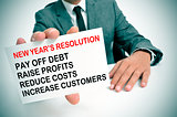 businessman with a list of new years resolutions