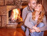 Loving couple near fireplace