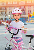 Cute little girl with bicycle