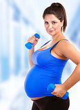 Pregnant woman do fitness